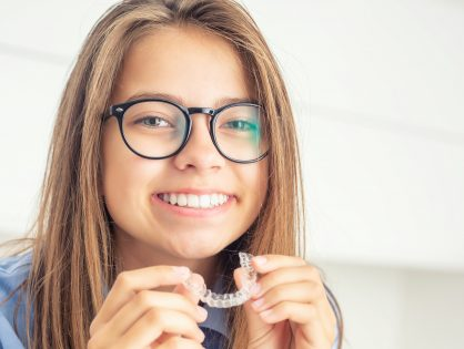 invsalign teen - Young girl with dental invisible braces.